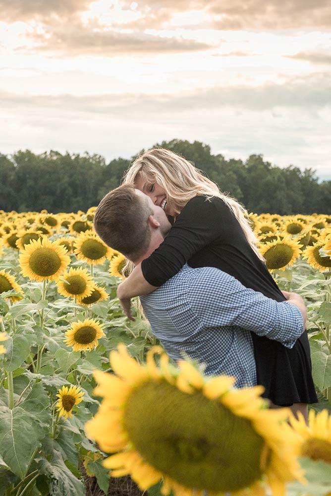 Couple in sunflower fieldl