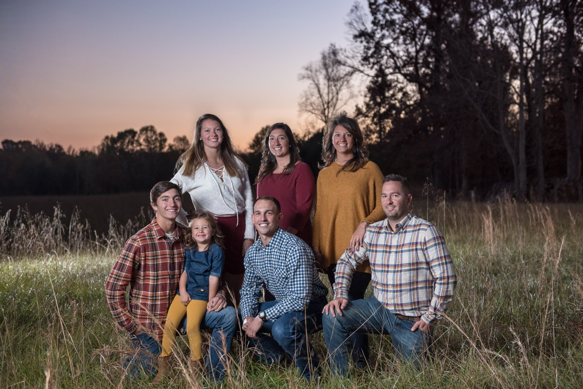 Large Family in Field at Sunset