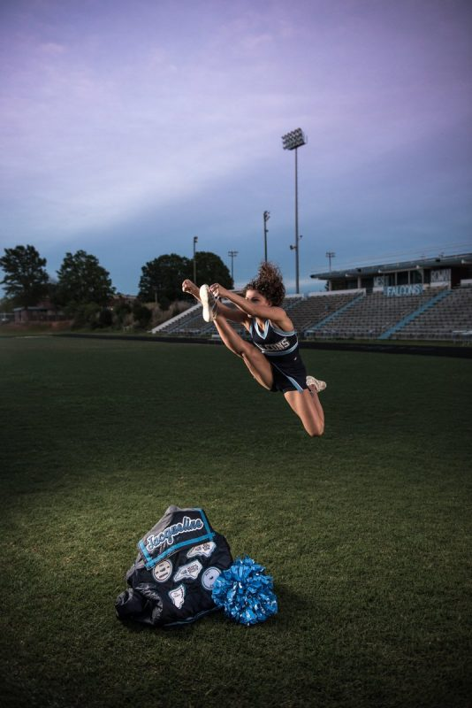 Senior Cheerleader doing stunt